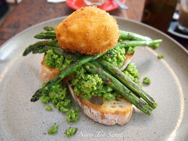 Smashed peas and broad-beans with dill, mint and grilled asparagus with a crumbed egg $14.50AUD