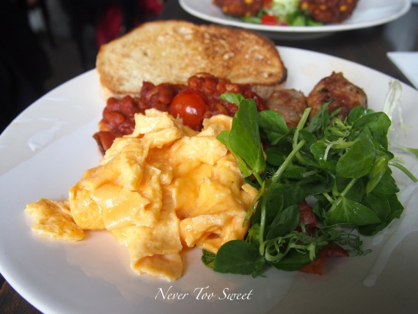 House bacon, bean ragout, pork and veal breakfast sausage and scrambled egg $19.50 AUD