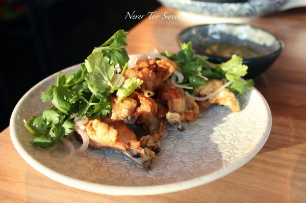 """""""Kai Chae Nam Pla Tod"""" Marinated chicken spare ribs with nam jim talay and pickled shallots $12.90"""