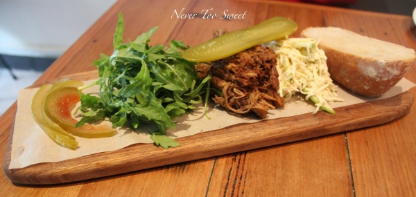 Slow Roasted Pulled Pork open on a board like a sandwich great to share $19