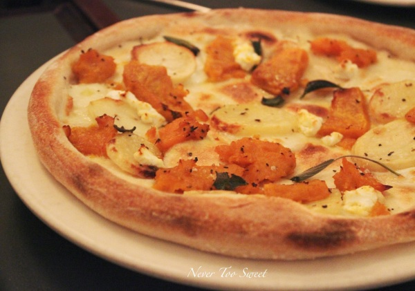 Bianca pizza with pumpkin, potato, goat's cheese, buffalo mozzerella and sage $17.5