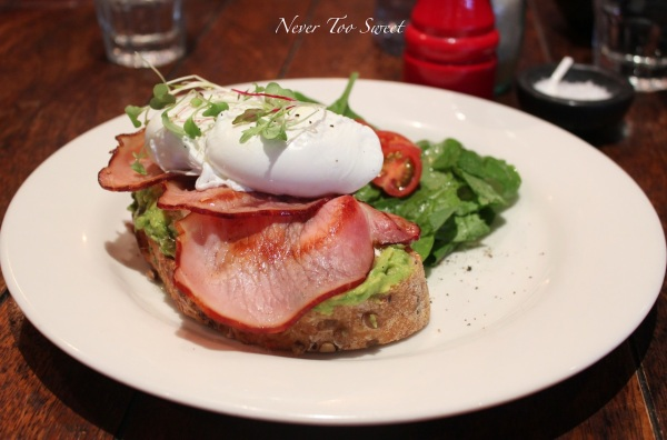 Smashed avocado & Persian fetta on 6 grain w/smoked bacon & poached eggs $18
