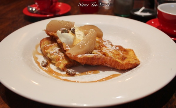 Croissant French Toast with poached pears, candied pistachios, Crème fraîche and maple syrup $16