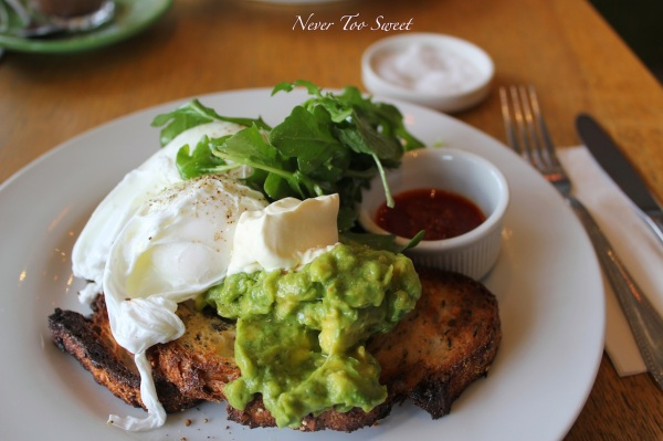 Smashed avocado with sour cream, chilli oil and poached eggs $13.5