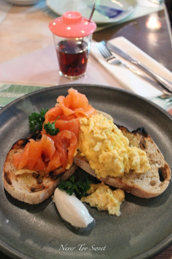 Home-smoked lemongrass cured salmon, scramble eggs and coconut reduction with brioche $17.5