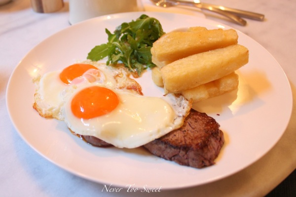 Breakfast Steak with sunny side up eggs and chips $