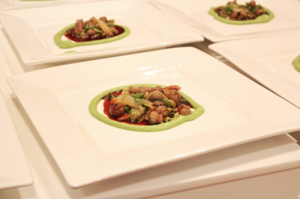 Plating up with pea puree and mushroom mix
