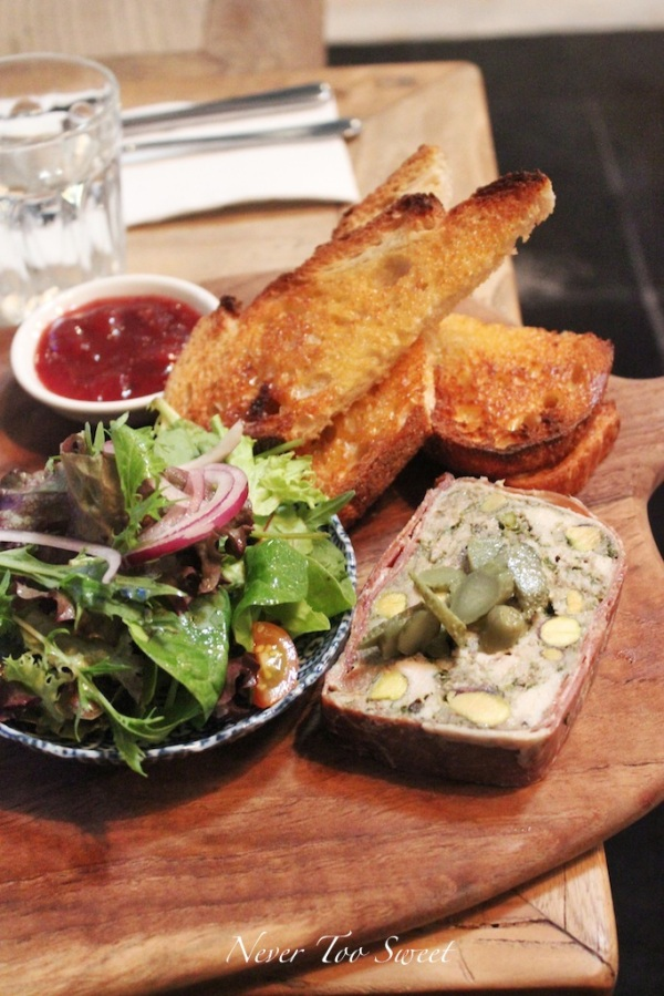 Terrine of chicken and pistachio with crusty bread, chilli/cranberry relish and a salad of side $15.9