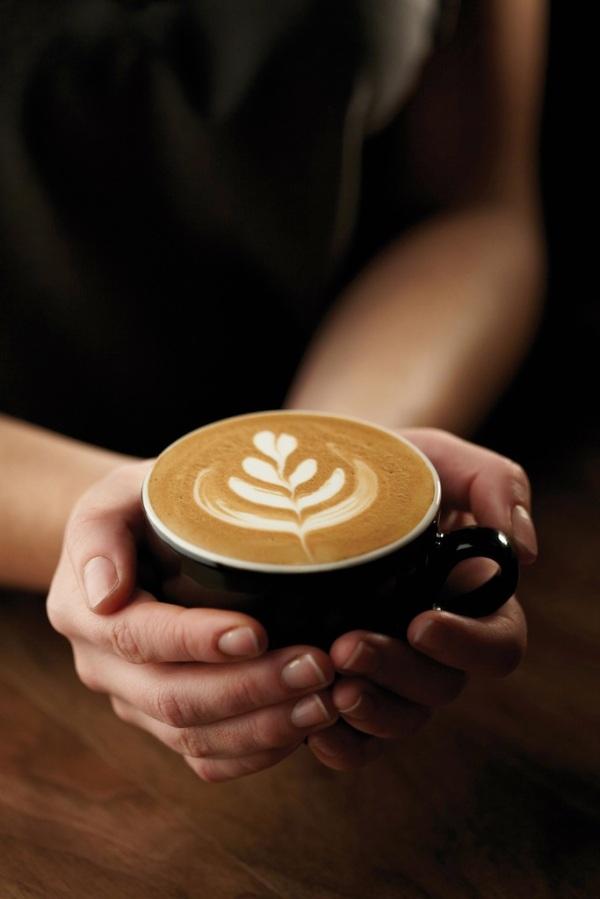 Hudsons Coffee_Hand-with-coffee