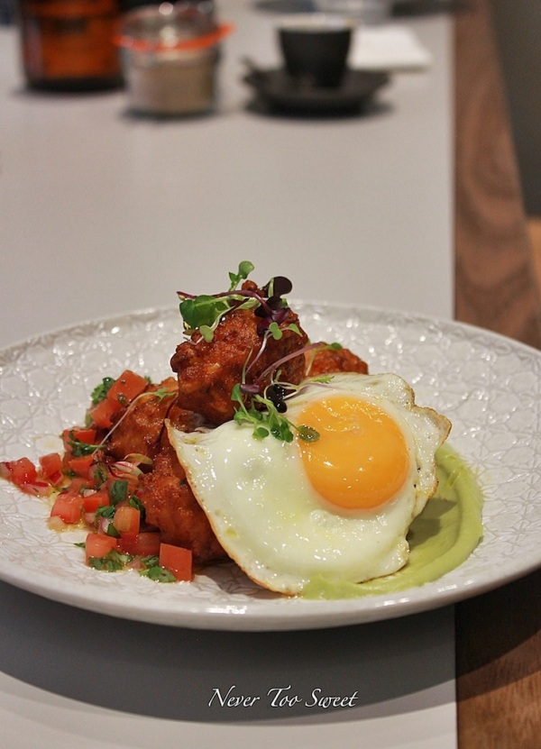 Sweet corn fritters, avocado mousse, fried eg, tomato and coriander salsa $16