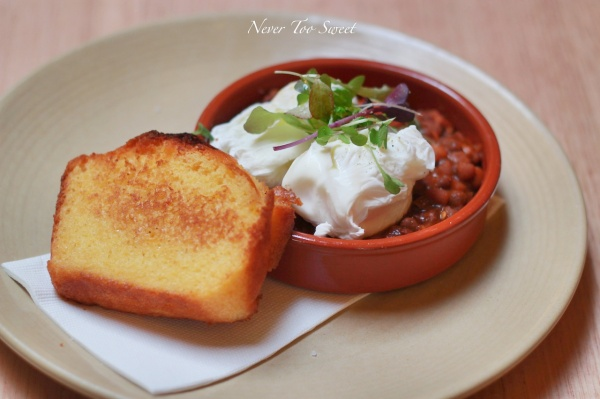 Bacon & Chipotle baked beans with cornbread and poached eggs $14