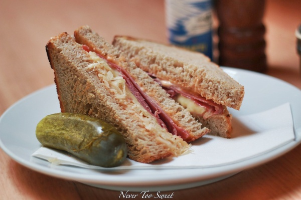 Toasted Reuben sandwich on light rye with corned beef, gruyere, sauerkraut, Russian dression and dill pickle $13