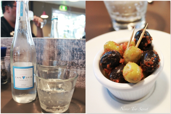 Sparking water and marinated olives