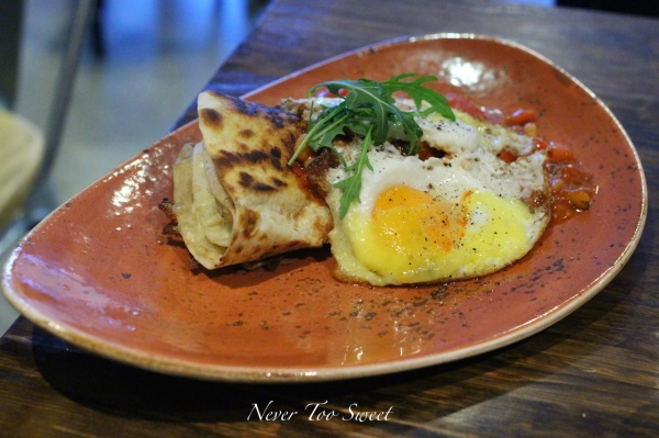 DMH Signature 2 fried eggs, chorizo, oven baked cheesy tortilla and topped with fresh tomato and bean salsa $13.50