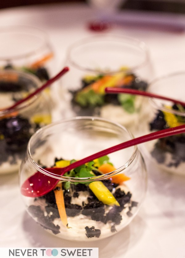 Soft goats curd with edible soils and heirloom carrots