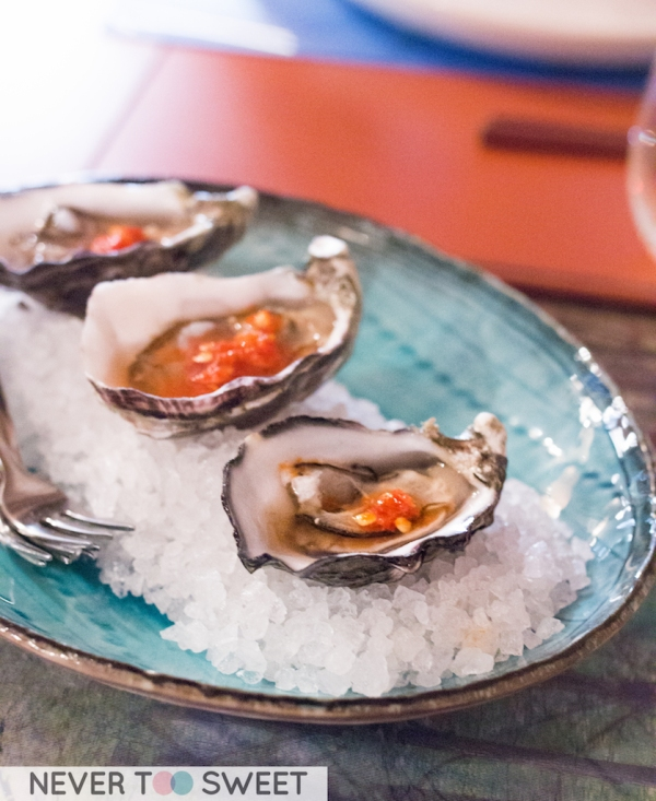 Freshly shucked oysters with red nam jim sauce $4 each