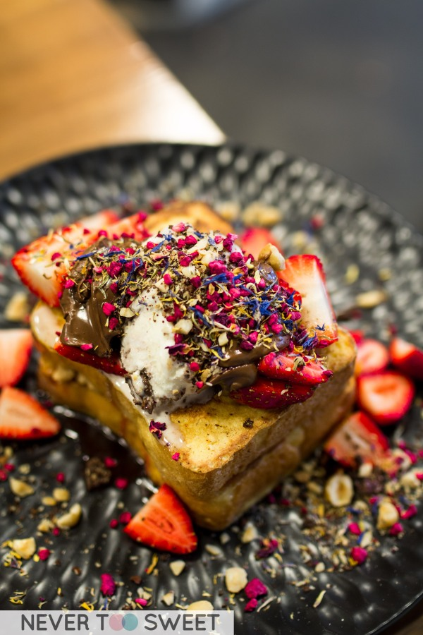Brioche French Toast with peanut butter, strawberry jam, Nutella, Chocolate cookie crumbs and hazelnuts $16.50