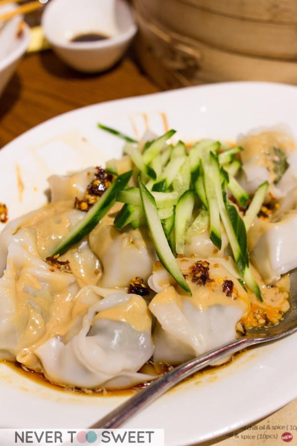 Pork wonton with peanut butter, red chilli oil & spice $11.5
